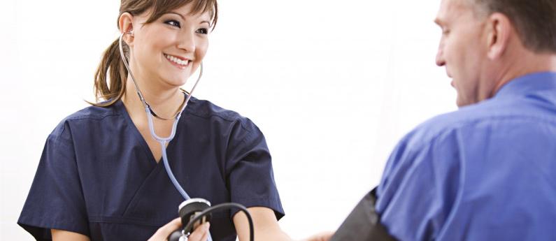 Nurse taking a patient's blood pressure.