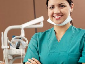 A dental assistant in a dental office.